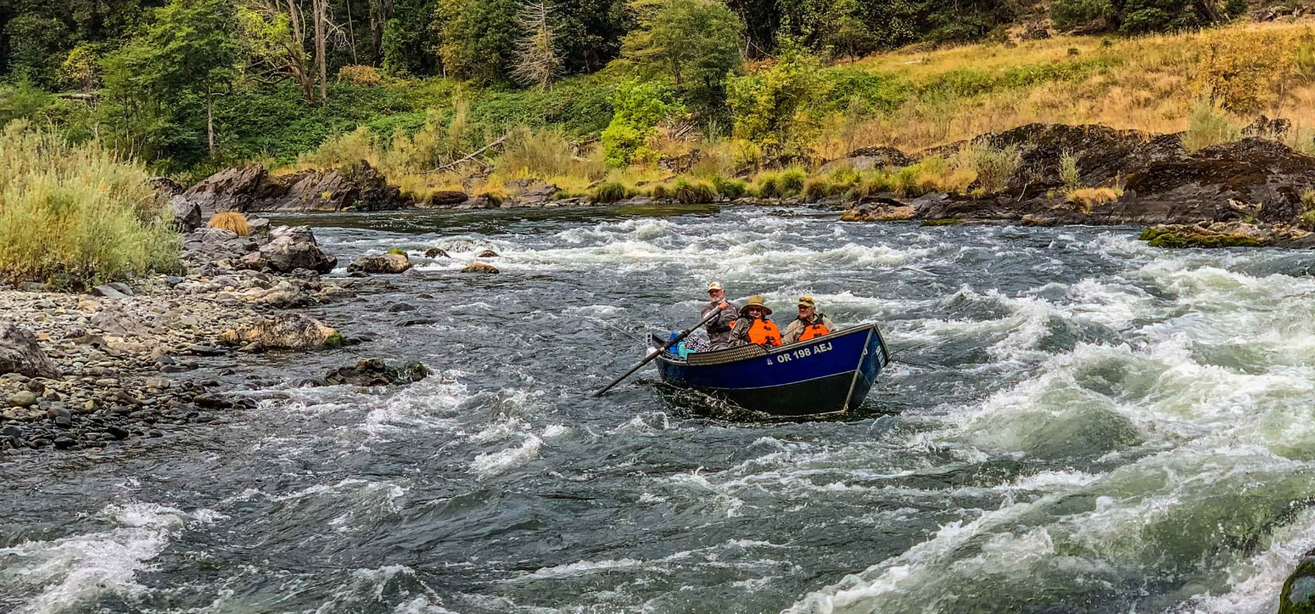Rogue river drift boat at horse shoe bend rapid